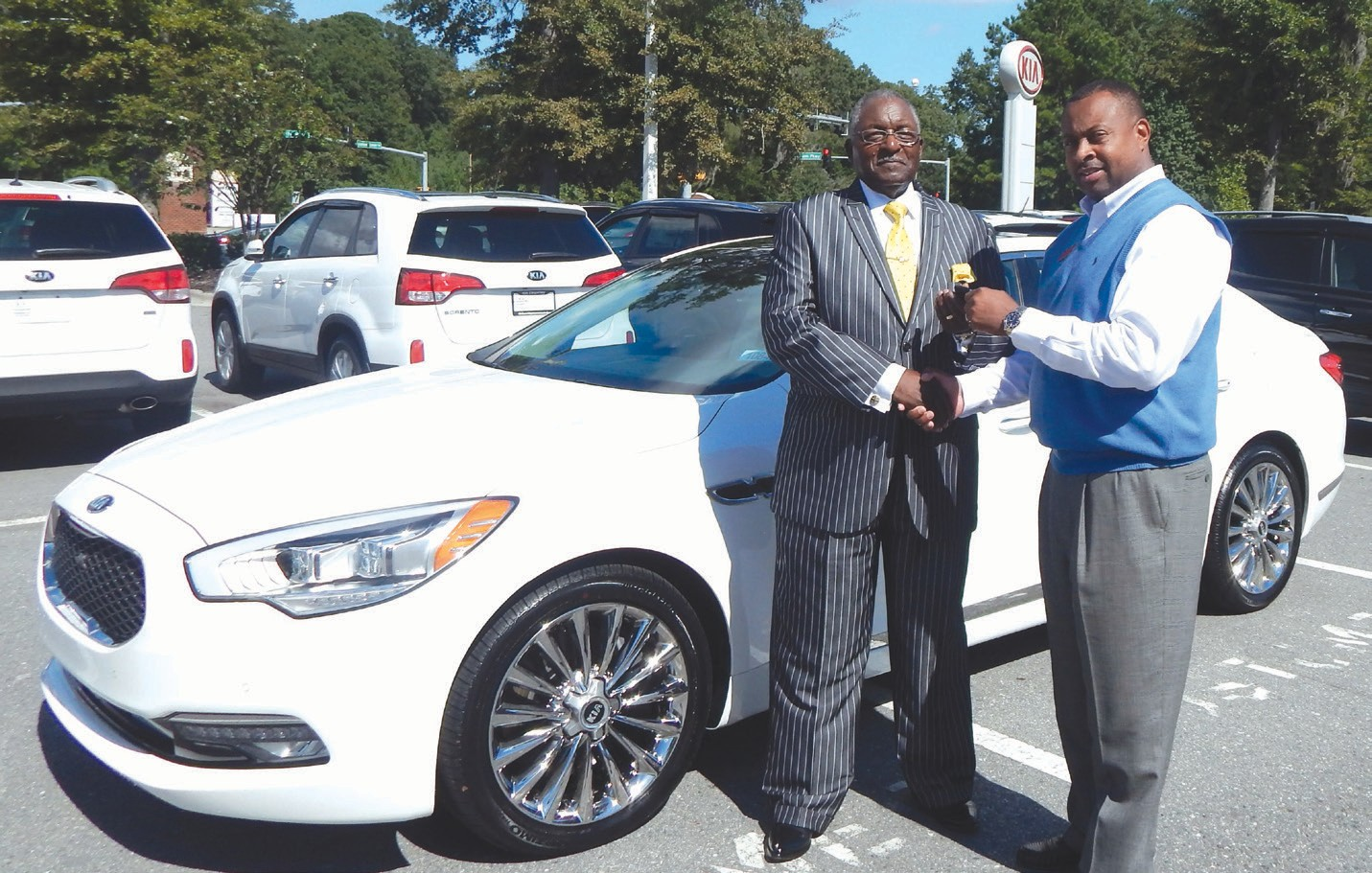 Rev. Samuel Kenty (L) received the keys from sales manager Reggie Moore during Pastor Appreciation Celebration