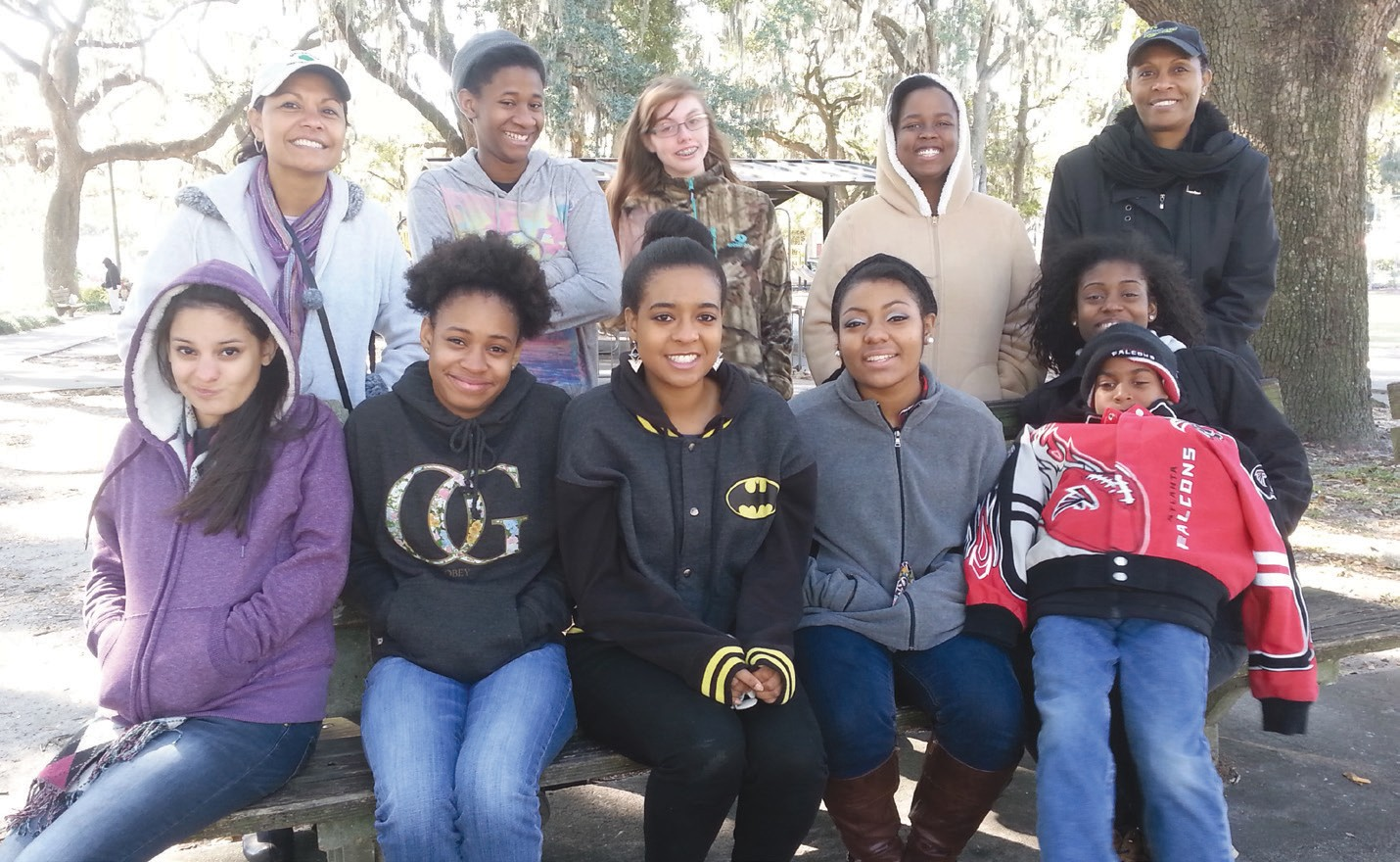 Front row - Rachel Crawford, Alexzia Clovis, Zysha Smiley, Asija Cueto, and Raquel Williams with her brother Matthew. Back row: Co-leader, Maria Crawford, Liza Clovis, Kristen Ragan, Nariel Tribble, and Troop Leader, Sharon Smiley.