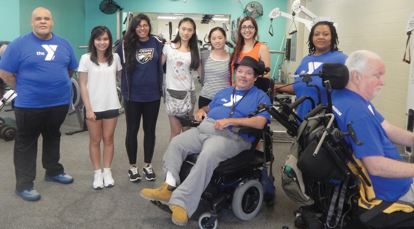 (L to R) Michael Jackson, YMCA Trainer along with Emory students Chi Le, Krishna Suhagia, Alina Zhang, Jenny Fu, and Shelly Saini along with program participants