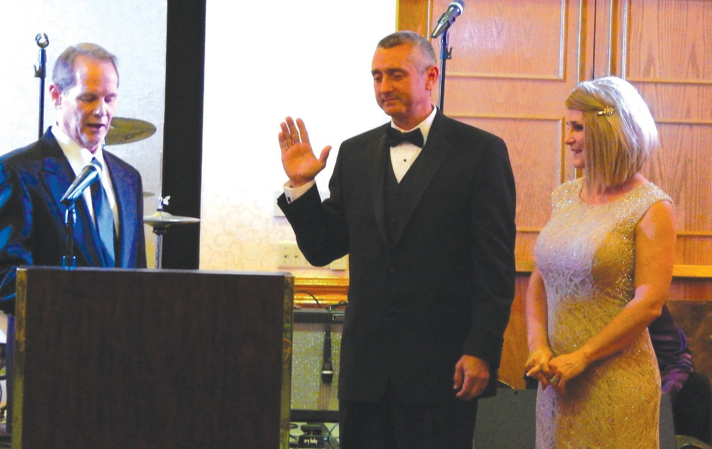 Rande Duke administers the Oath of Office to Kevin Kirsch as wife Michelle Kirsch looks on
