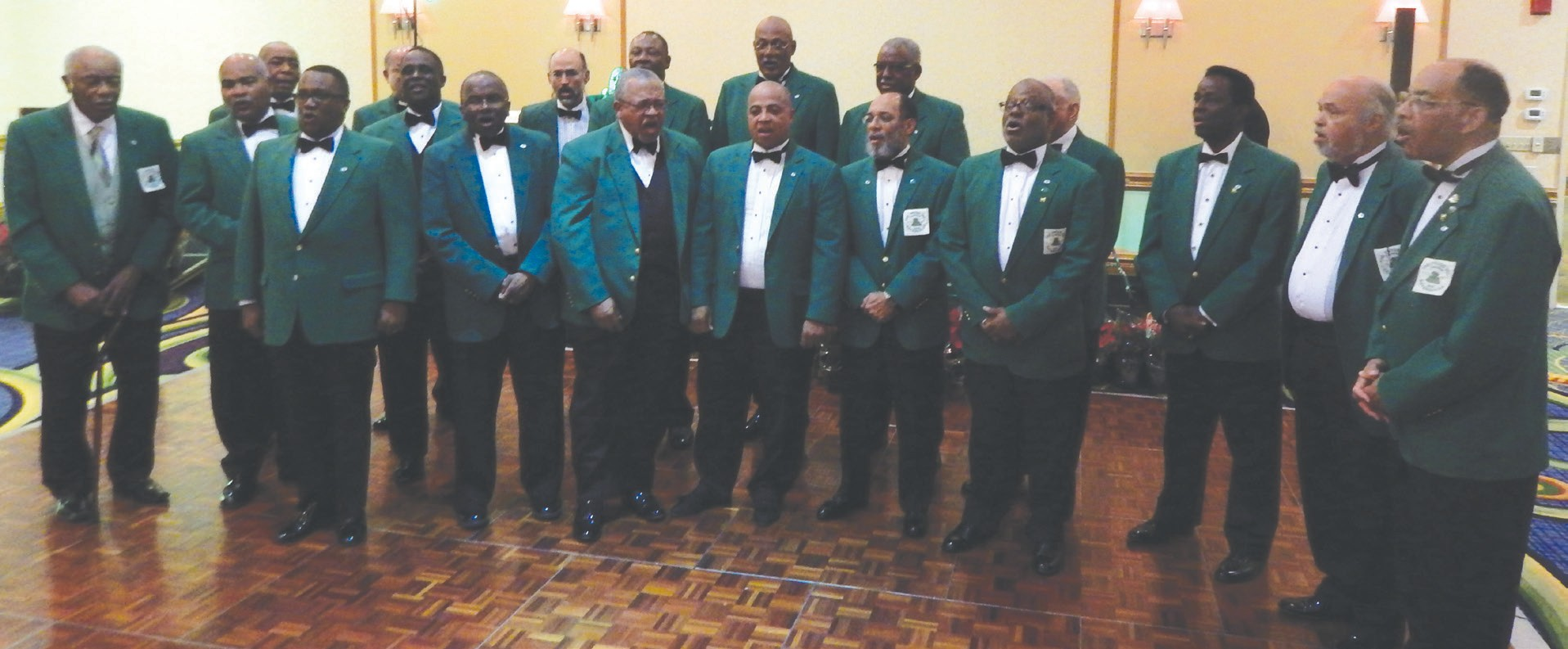 Members of the Frogs, Inc. serenade their guest at the annual Christmas Gala