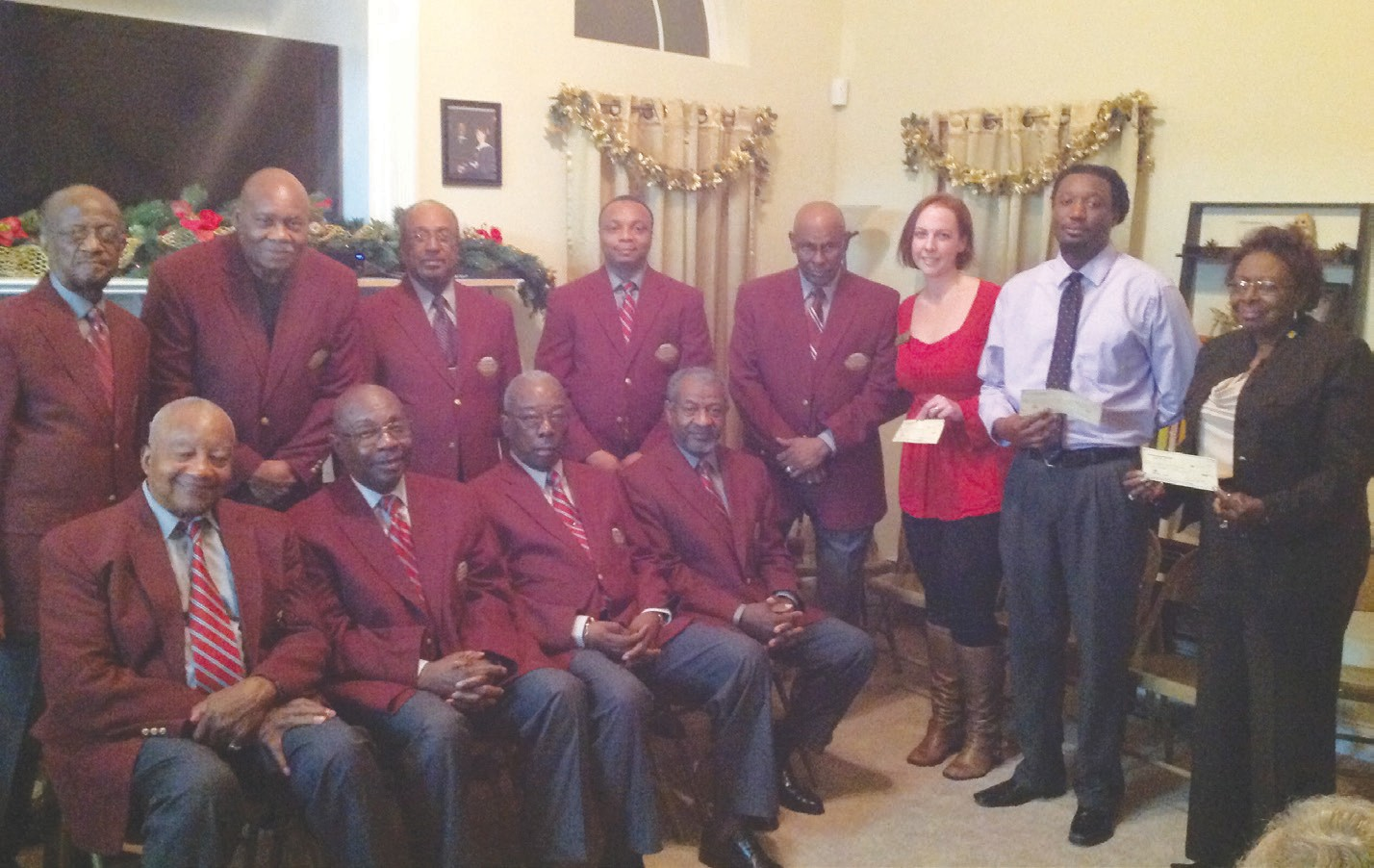(L to R) Seated: William Mosley; Johnny Wilson; Christopher Jackson; Thomas Cornelius; Standing: Charles Johnson; George Jackson; Edward Smith; Paul Mosley; James Franklin; Recipients: Danielle Paul, Nehemiah Harden, Catherine Jackson (Members not present: Billy Kearse; Gilbert Henry; Eugene Washington; William Benyard; and Michael Glover)
