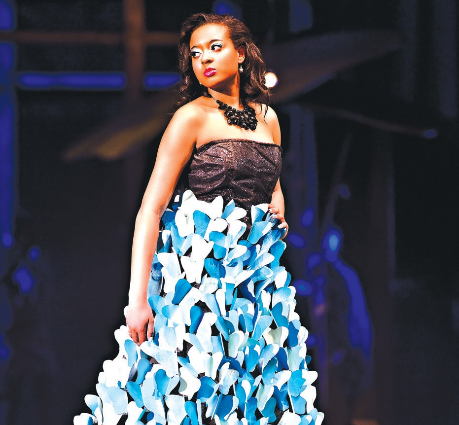 "Zysha Smiley, student model for the Junk 2 Funk Fashion Show, is portraying ""Morpho Mistress."" Her dress was designed by Rachel Fretty - Morpho Butterfly. It is made of window screening, craft paper, and ribbon."