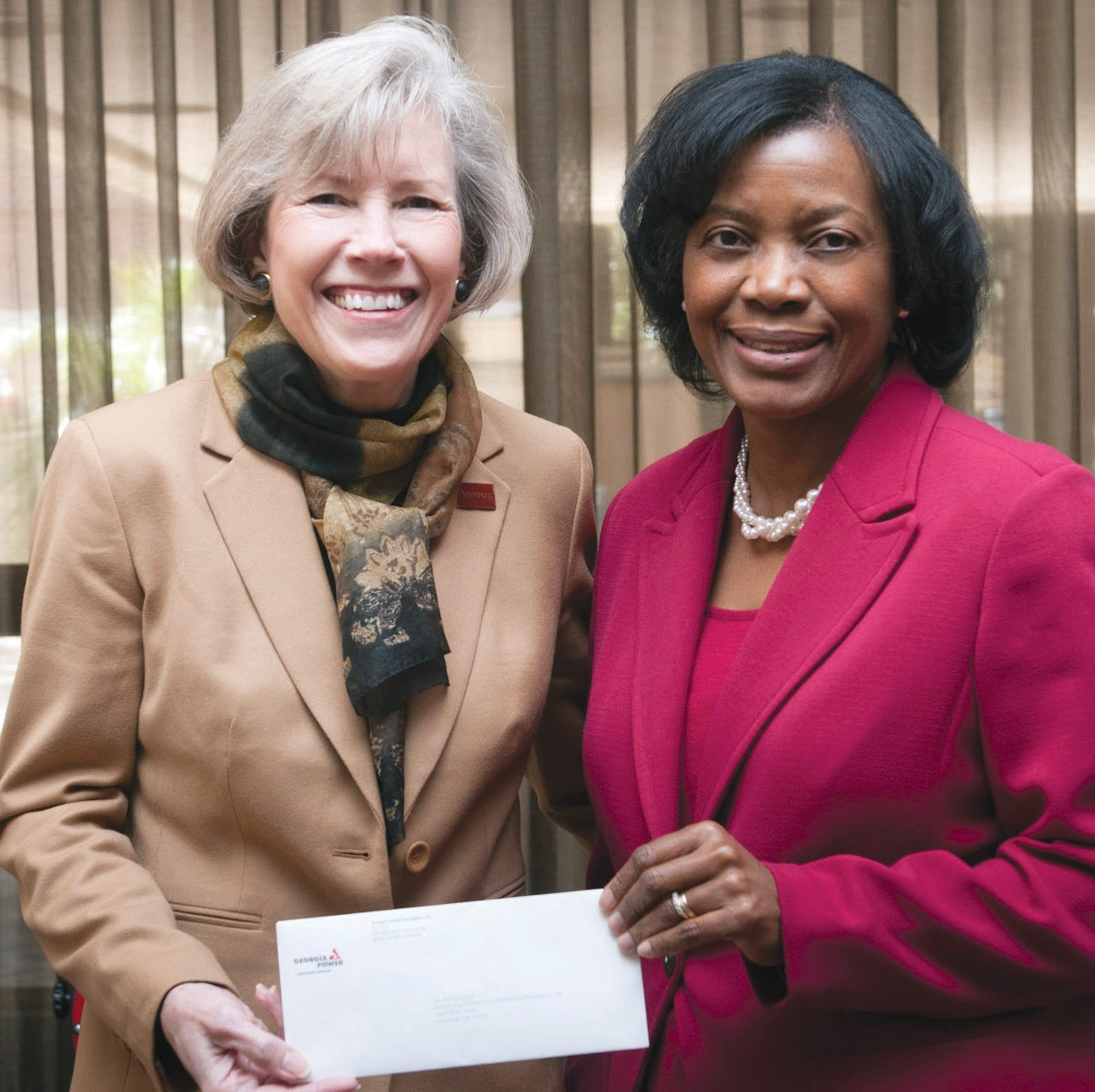 Georgia Power's Vice President Cathy Hill (right) recently presented Armstrong president Linda M. Bleicken (left) with a check for $20,000 from the Georgia Power Foundation to support Science, Technology, Engineering and Mathematics (STEM) education initiatives at the university.