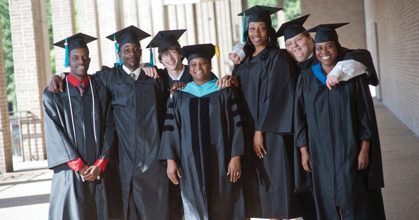 Savannah Technical College GED® graduates celebrate with instructors at the 2014 STC graduation. These students attended free GED® test preparation classes at Savannah Technical College prior to passing their exams.