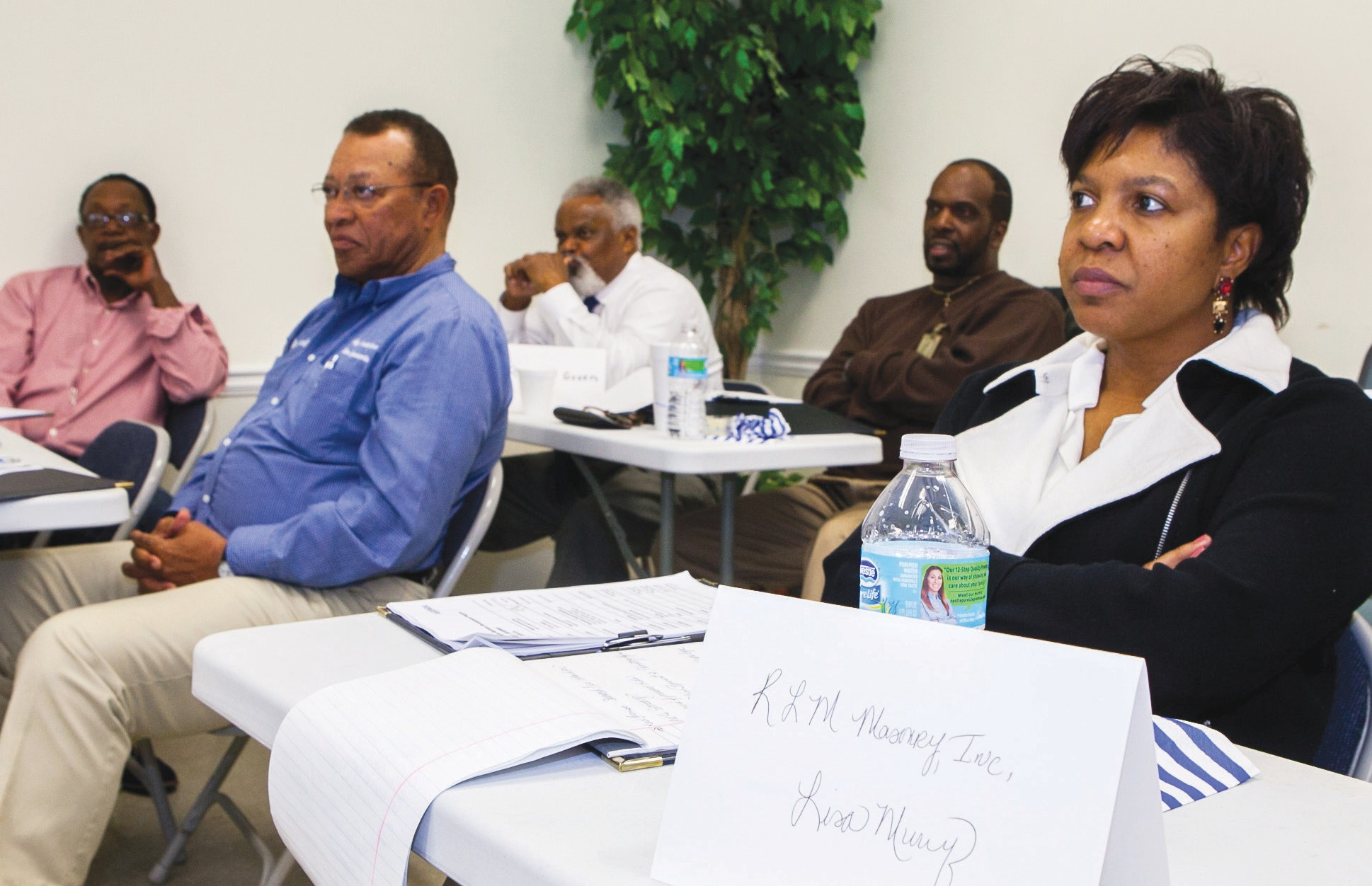 Participants in the 2015 Minority Contractor Business Development Program learn how to enhance business acumen and interpersonal and relationship-building skills.