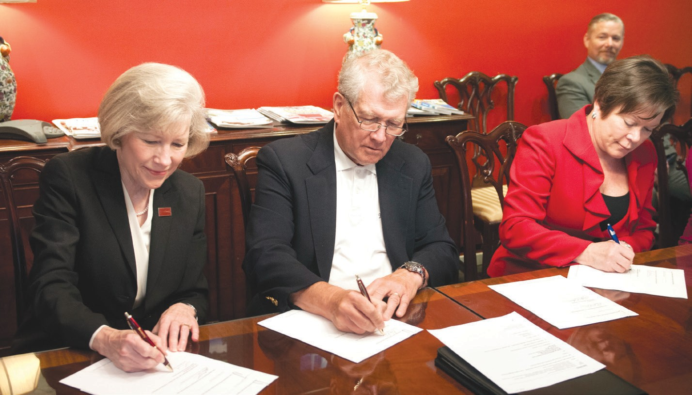 Armstrong President Linda M. Bleicken, The Landings Military Family Relief Fund Chair Tom Osborn and Savannah Tech President Kathy Love (l-r) recently signed a gift agreement establishing a new scholarship fund to support local military spouses.