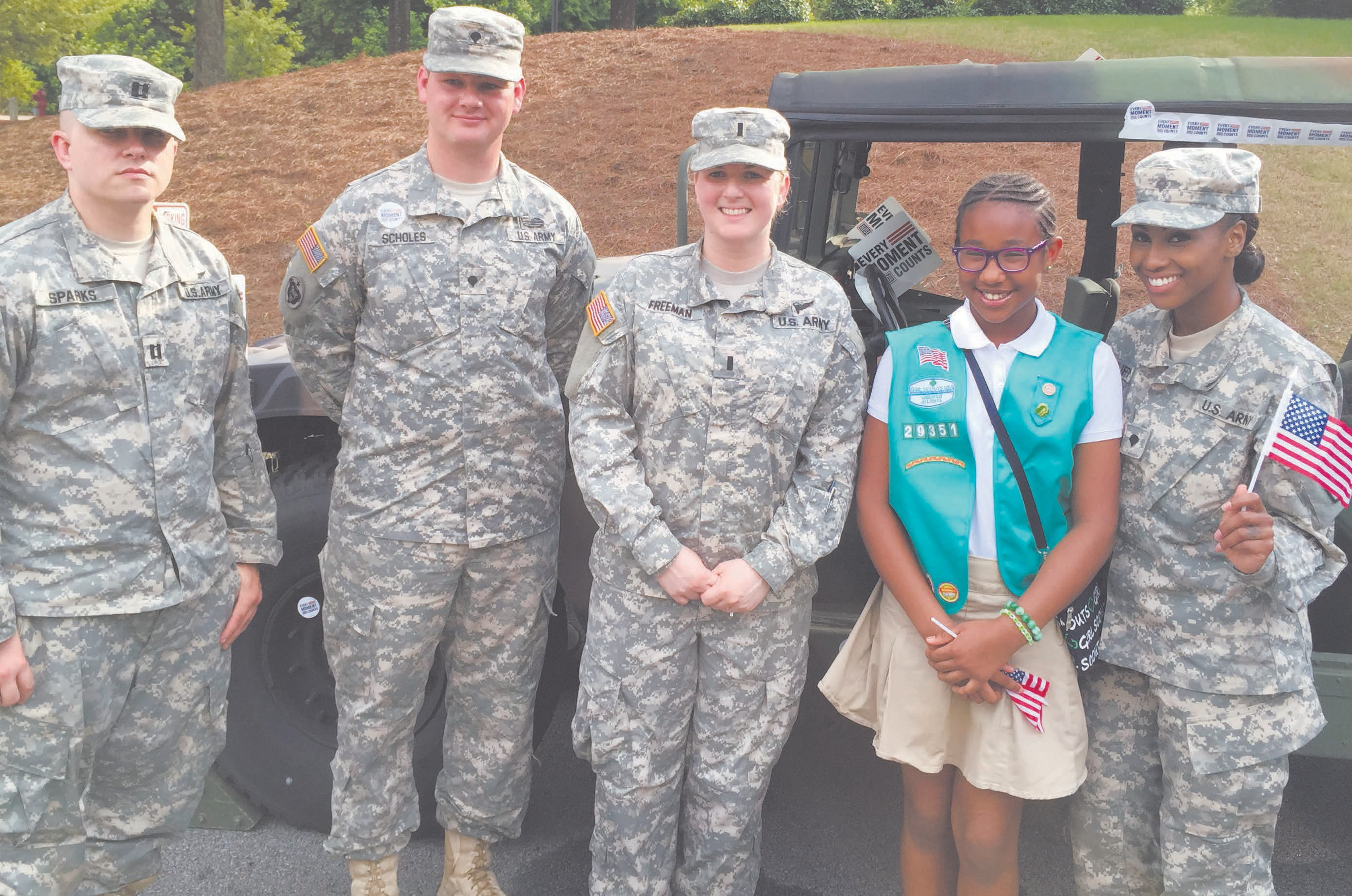 Girl Scout Lauren James is pictured with members of the active military. Lauren is the daughter of Attorneys Robert, II and Angela James, and the granddaughter of Robert and Shirley James of Savannah. Lauren would like to thank her many friends, including those in the Savannah area, who supported the Smiles 4 Military Sendoff Program and her sales of Girl Scout Cookies.