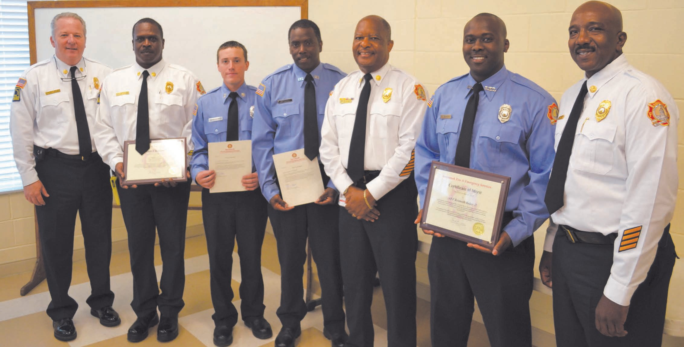 Savannah Fire Chief Charles G. Middleton presents awards to MFF Baker & Engine 6B firefighters