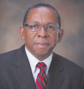 Dr. C. Reynold Verret