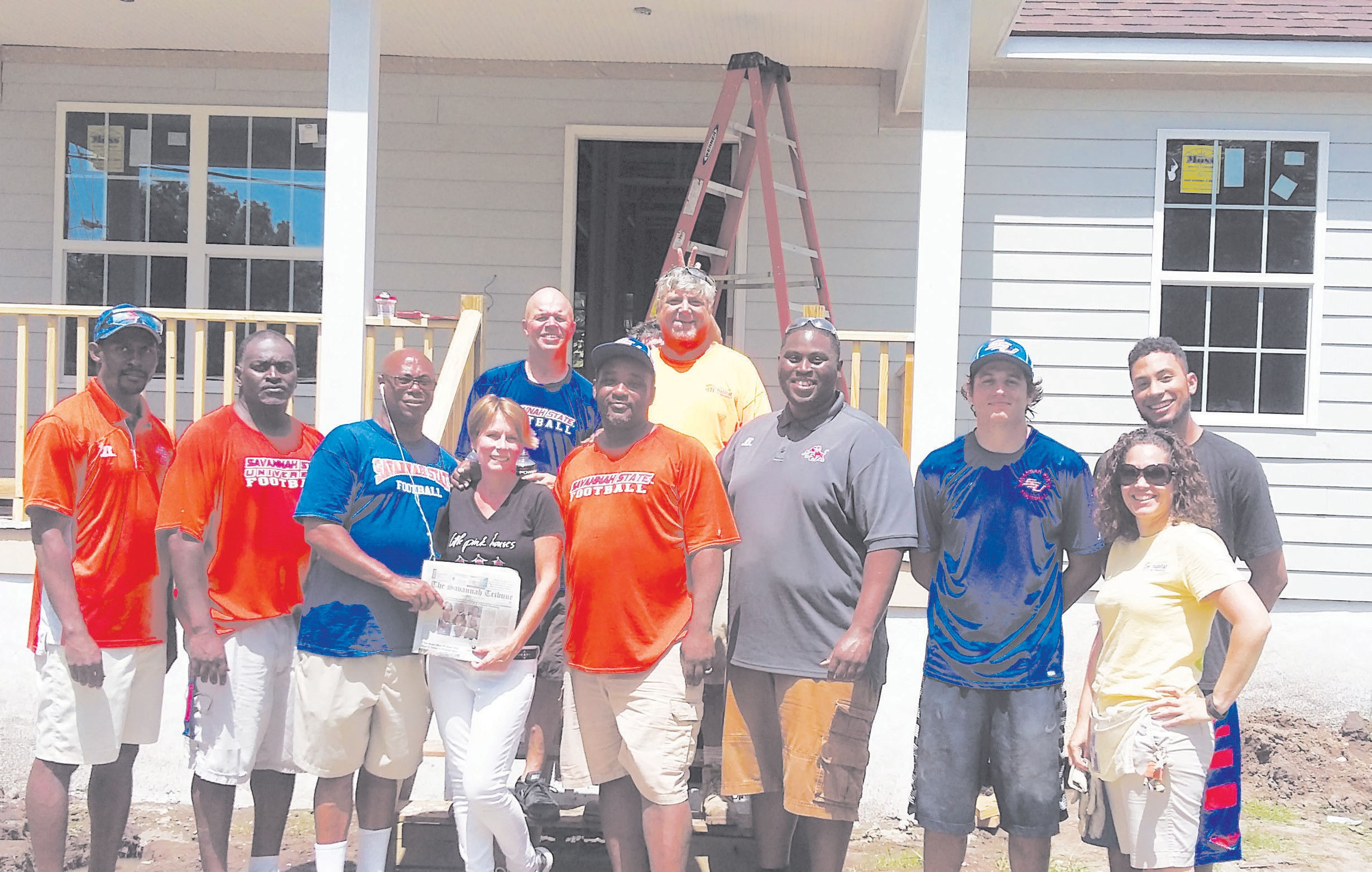 SSU Football Coahing Staff including Danita Townsend and head football coach Ernest Wilson volunteer in building a house for Coastal Empire Habitat for Humanity