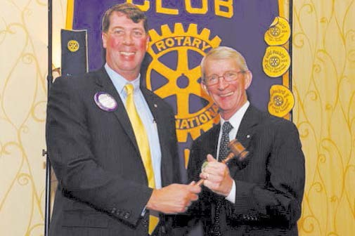 Holden Hayes, Outgoing Rotary President Regional President of South State Bank and Rick Monroe, New President of the Rotary Club of Savannah
