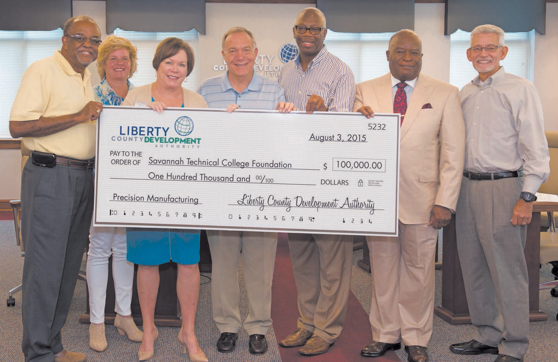 The Liberty County Development Authority approved a $100,000 pledge over five years to support the expansion of Precision Manufacturing training in Liberty County. STC President Dr. Kathy Love stands with LCDA board members.