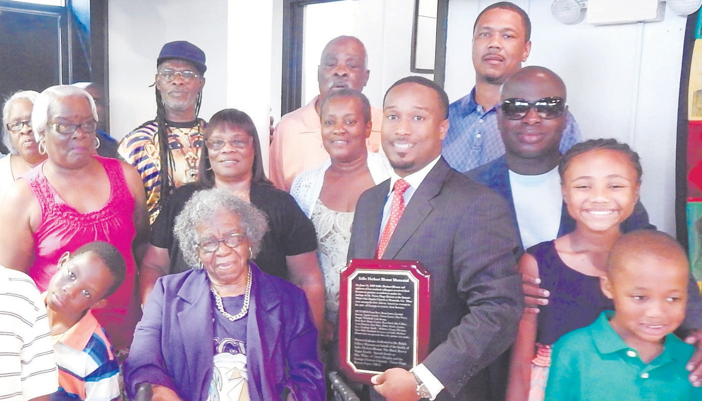 Pictured is the family of Midwife Sallie Herbert Blount including great great grandson Anthony Maxwell along with Carl Miller, Board Chair of RMG Civil Rights Museum