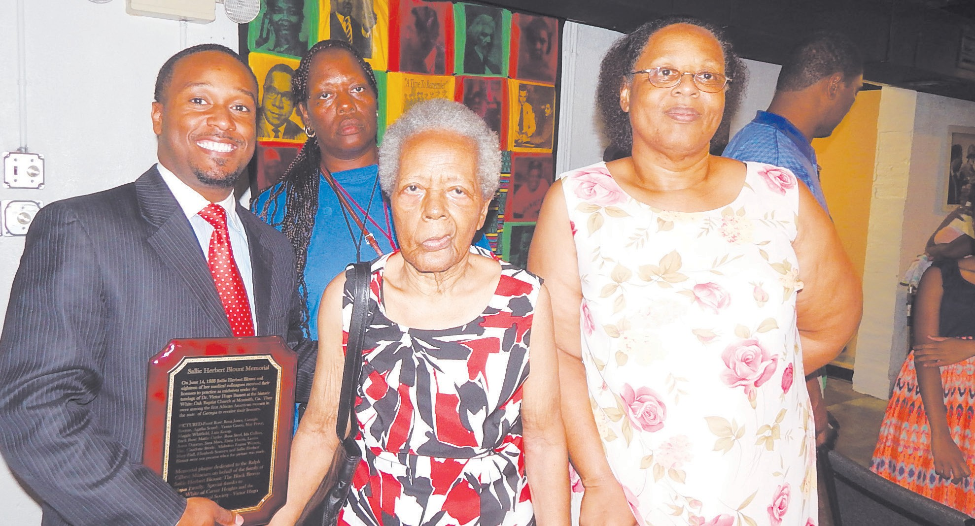 Carl Miller, Board Chair of RMG Civil Rights Museum pictured with Midwife Louise Day family including granddaughter Mrs. Reynolds (the eldest in the group)