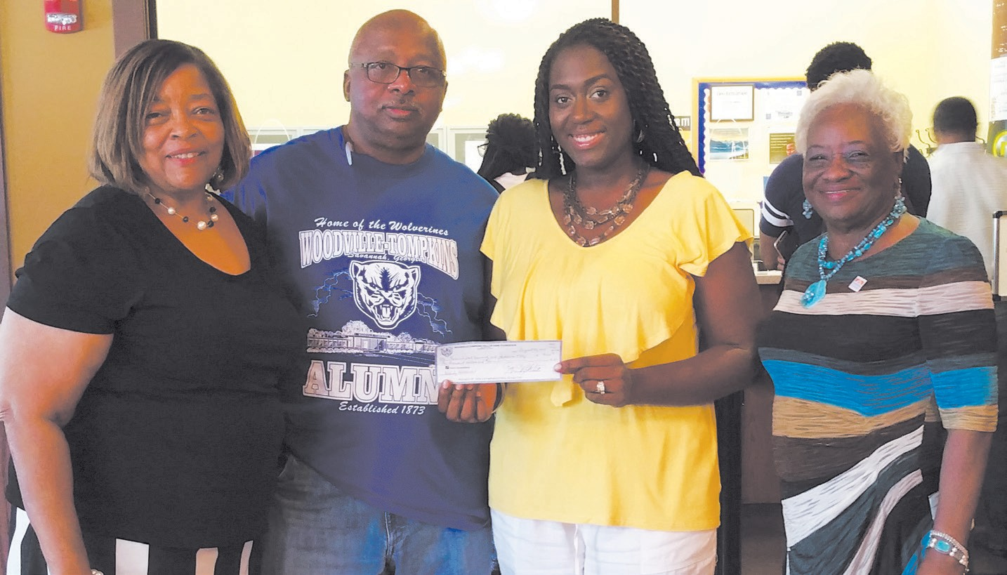 Pictured is President Chester Ellis, along with fellow Woodville-Tompkins Alumni Fredericka Wiggins and Rose Howsia Brown presenting the check to SSU Cashier Janeka Jackson.