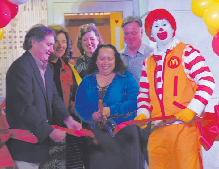 (L-R) Mark Gompels; Nina Gompels; Gloria Brack-Ford, SCCPSS; Kim Newman, Isle of Hope School Principal; Anjanie Gaouette, Store Manager; Larry Tate, Area Supervisor; and Ronald McDonald cut ribbon on new Montgomery Cross Rd location.