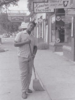 Earl Fonvielle in front of The Savannah Pharmacy, 719 West Broad Street, August 1960. Photograph courtesy of Savannah Development and Renewal Authority.