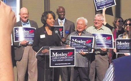 Attorney Tammie Mosley anounces her candidacy surrounded by supporters.