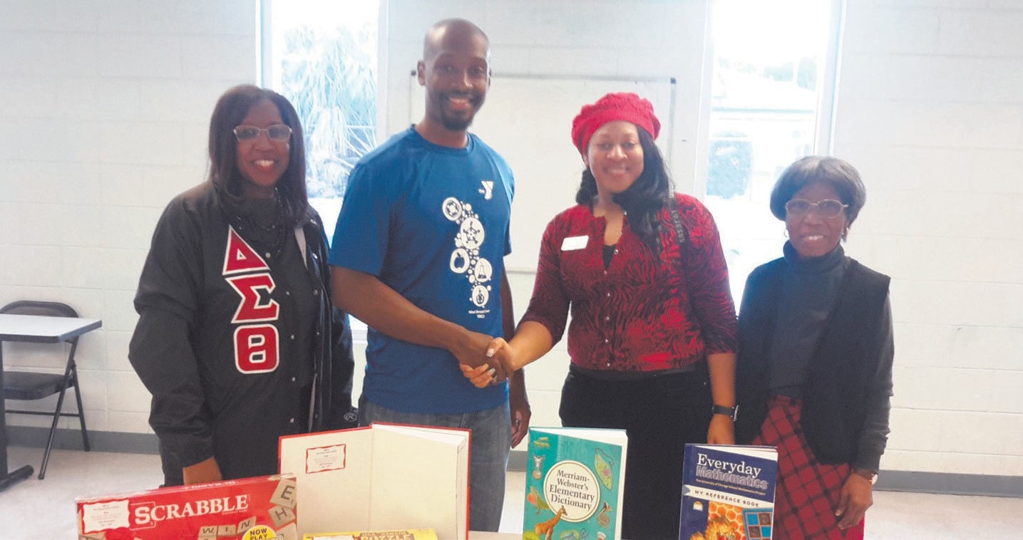 L to R: Shelia Eady, Trey Searles (Program Director at the West Broad Steet YMCA), Kamaria Shaw, Gladys Lambert