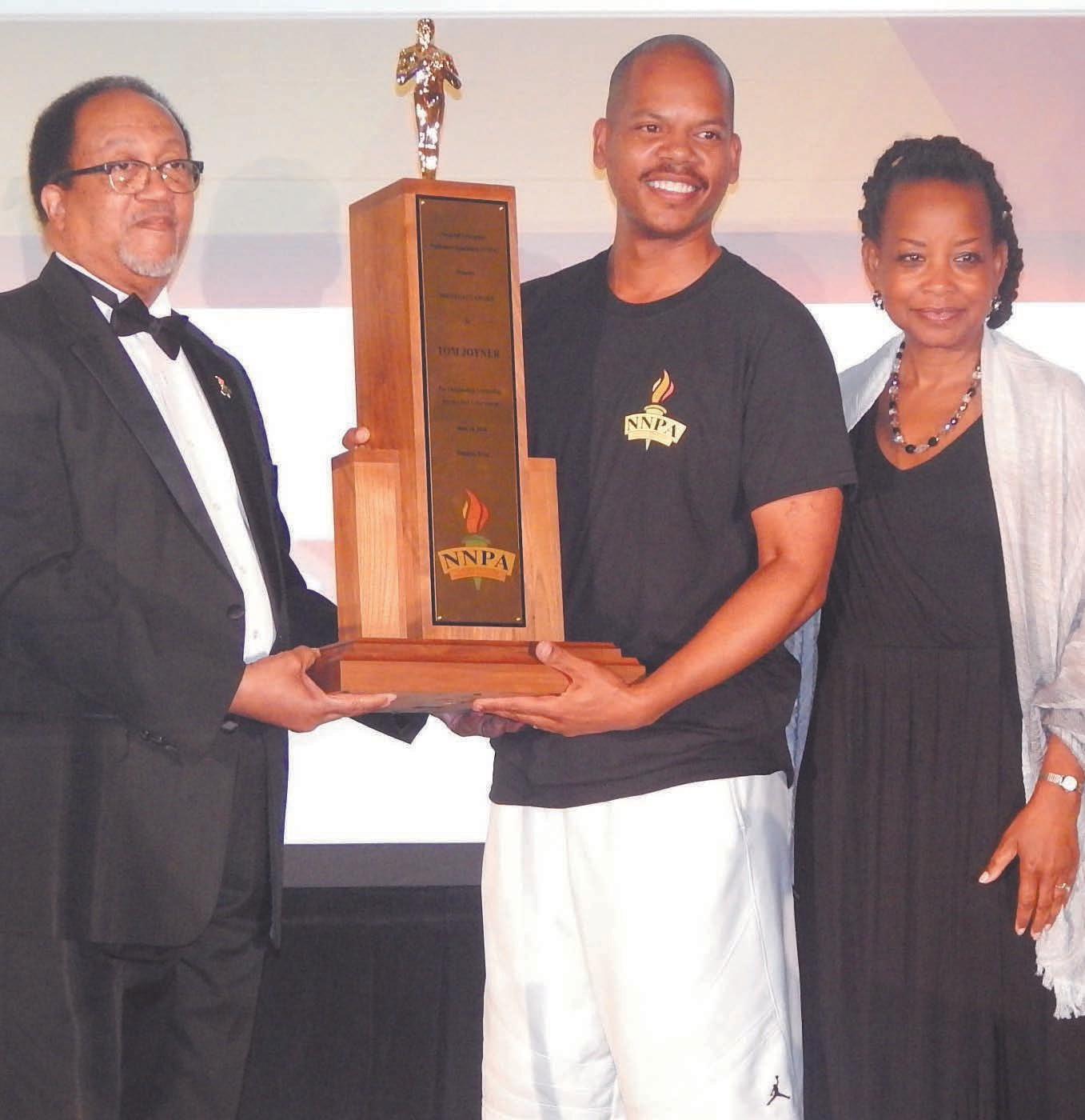 Oscar Joyner accepting the Legacy Award on behalf of his father, Tom Joyner presented by Dr. Ben Chavis and NNPA Chairman Denise Rolark-Barnes