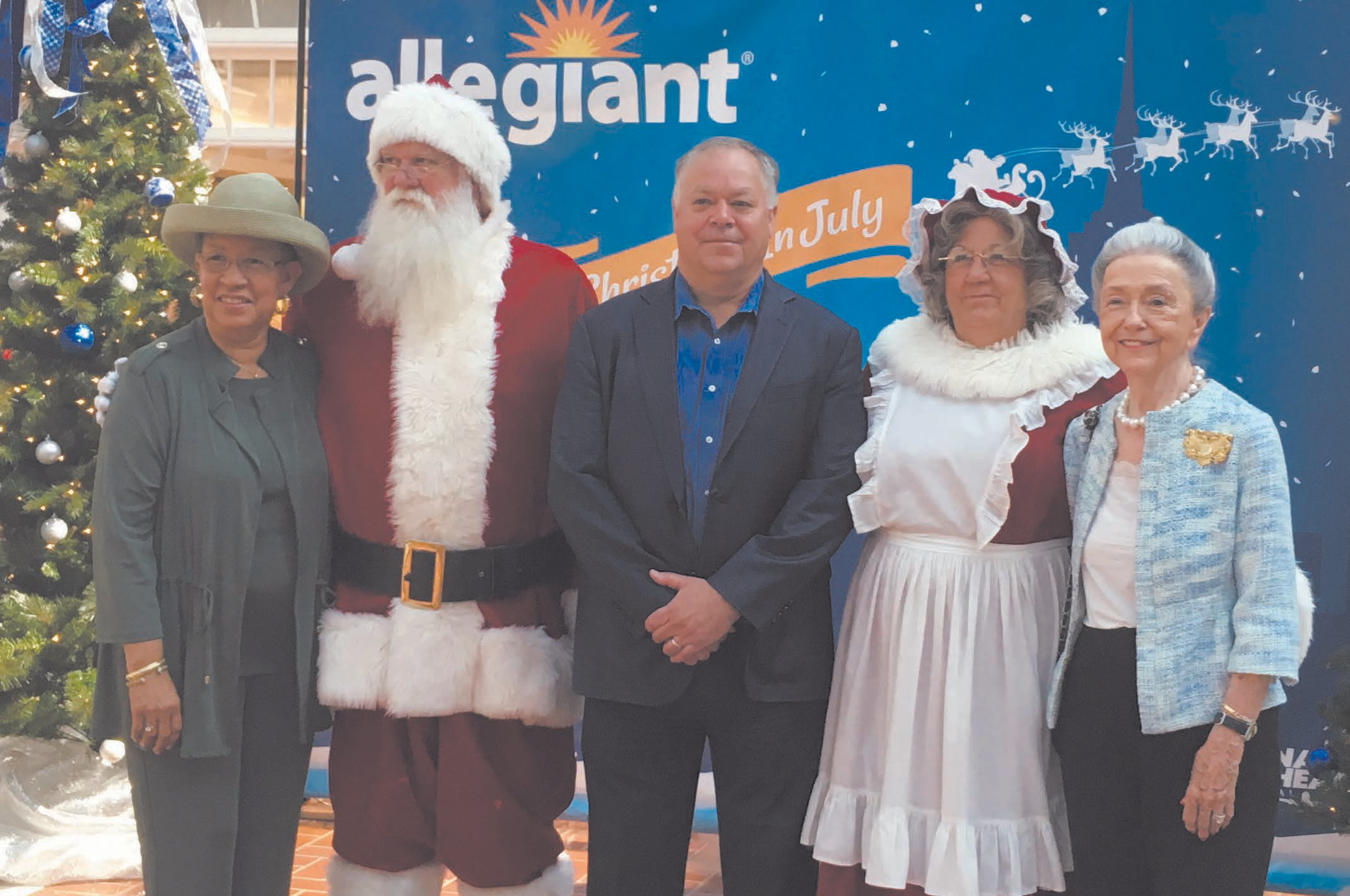 L-R:Savannah Airport Commission Vice-Chairman Shirley B. James, Santa Claus, Savannah Airport Commission Executive Director Gregory B. Kelly, Mrs. Claus, and Savannah Airport Commissioner Lois Wooten.