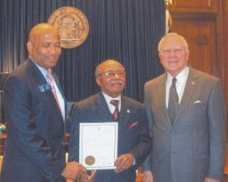 Elder Taylor (center) pictured with Gov. Nathan Deal (r)