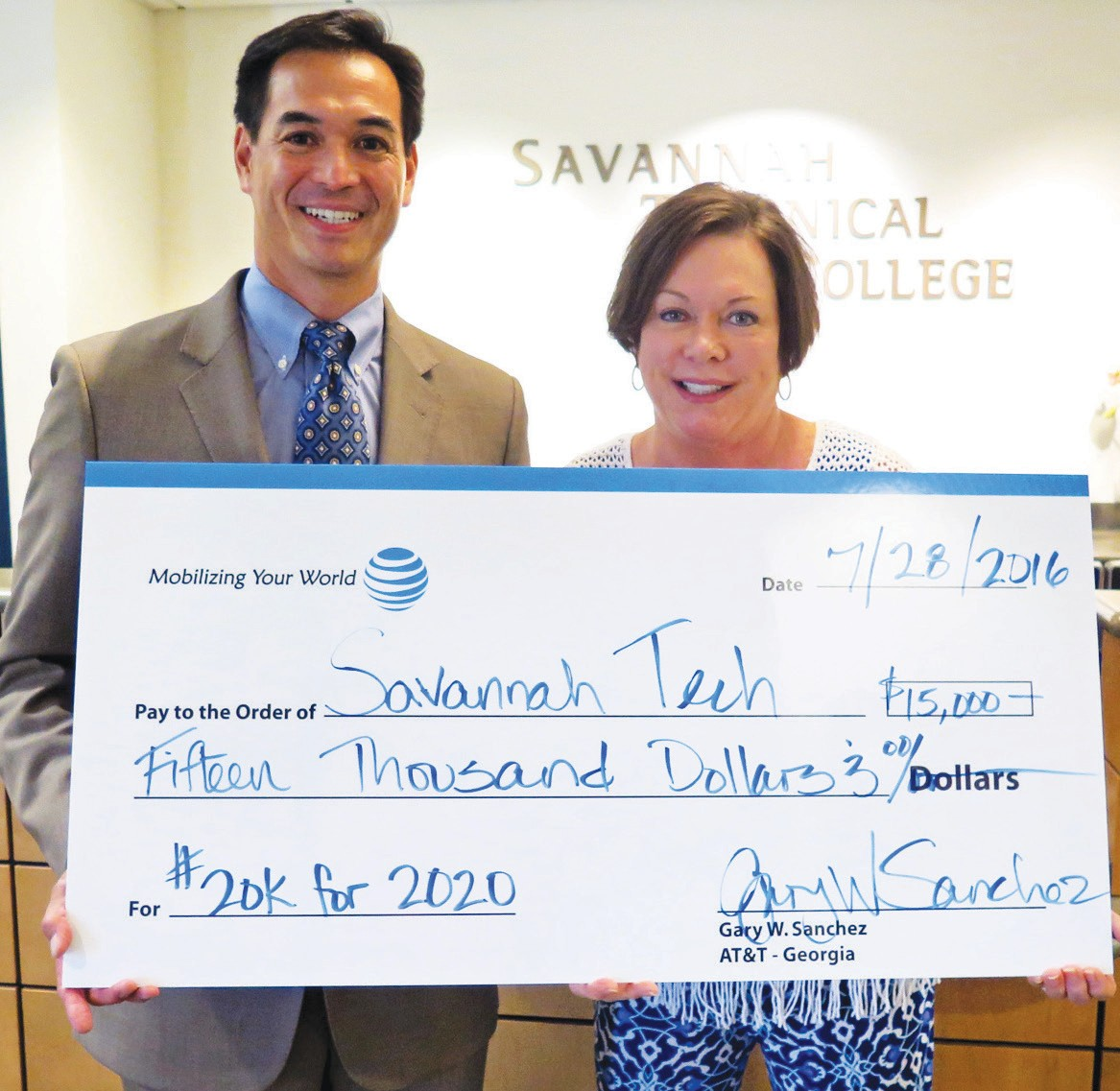 AT&T's Southeast Georgia Regional Director External Affairs Gary Sanchez presented a check for $15,000 to STC President Dr. Kathy Love to support workforce development in the #20kfor2020 competition.