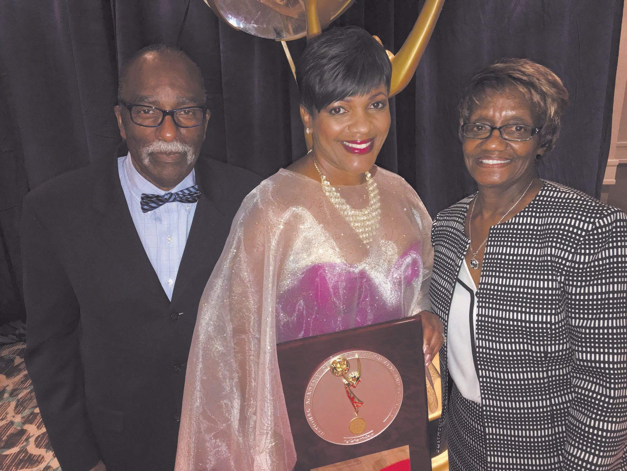 Tina Tyus-Shaw (Center) shown with father Willie Tyus and mother Dorothy Underwood