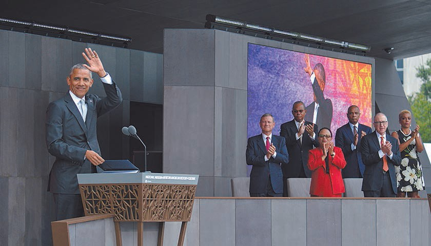 President Barack Obama waves to the crowd during the grand opening ceremony for the National Museum of African American History and Culture on the National Mall in Washington, D.C. (Freddie Allen/AMG/NNPA)