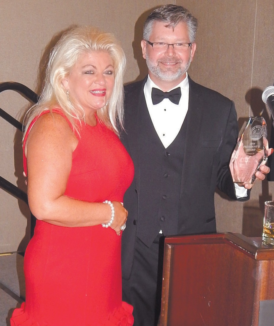 Savannah HBA Executive Officer Patty Rietkovich received Presidential Award from Neal Davis 2015/2016 HBAG Prsident