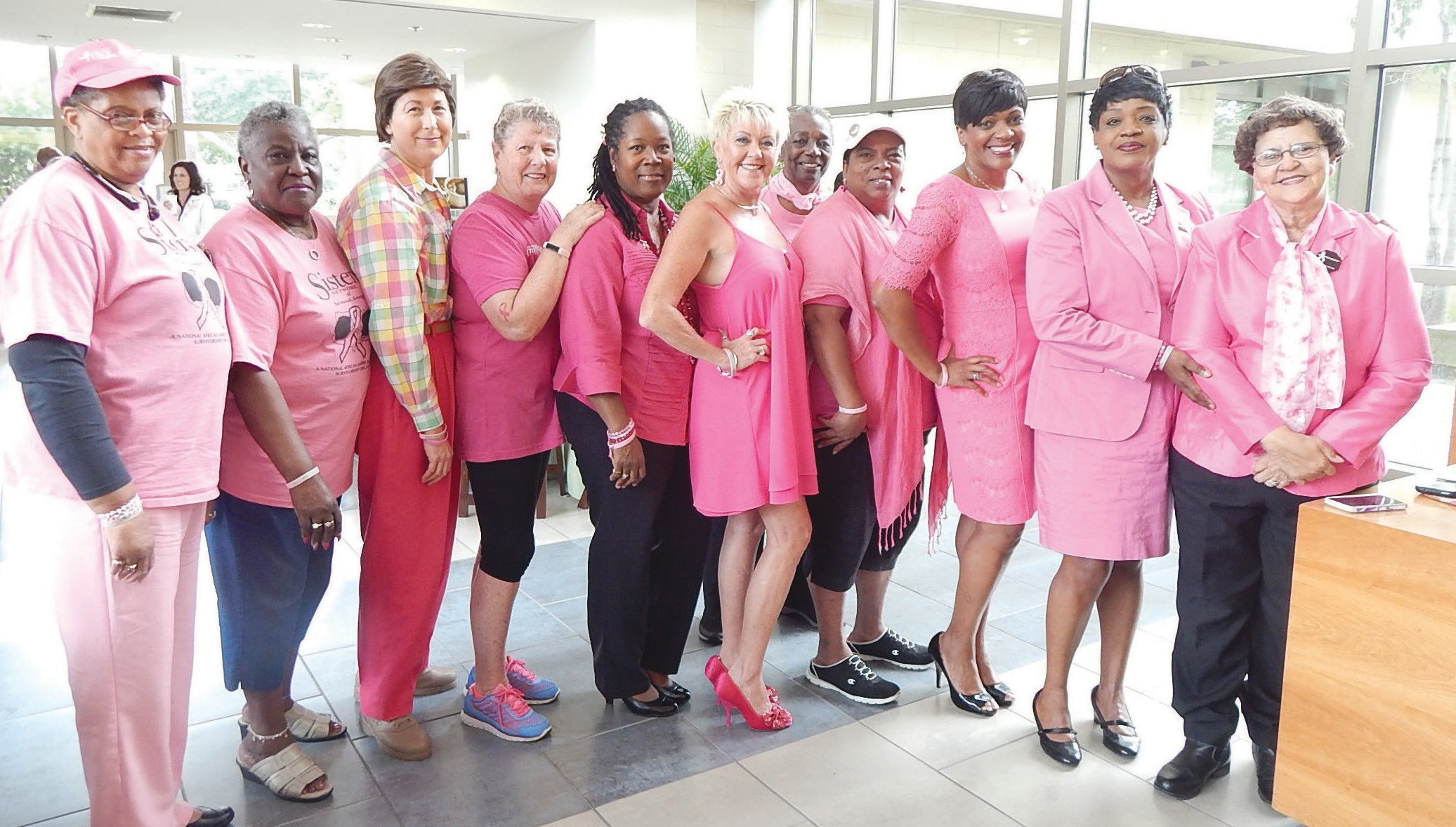 Tina Tyus-Shaw stands with other breast cancer survivors