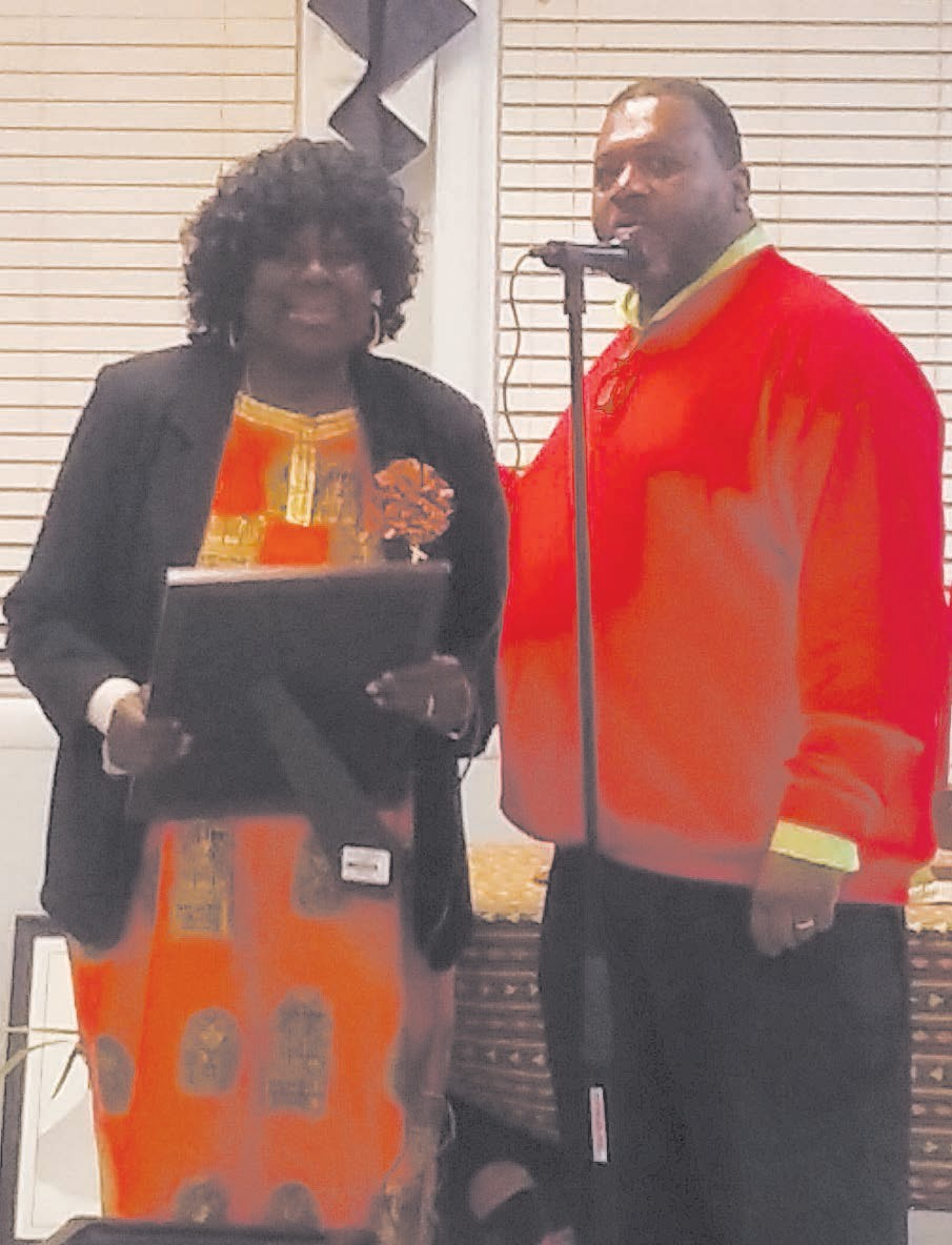 Commissioner Yusef Shabazz present proclamation to Dorothy Cohen of Kawanzaa of Savannah