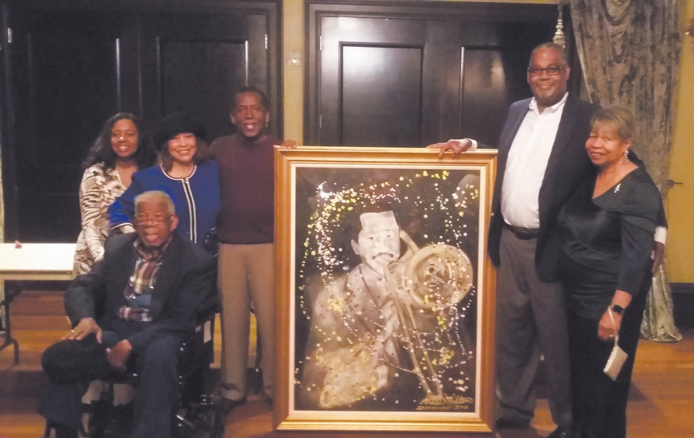 Ron Gantt (right) shown with wife after winning silent auction of painting of Jazz Artist Teddy Adams. Teddy Adams (left) is pictured with the Johnson family