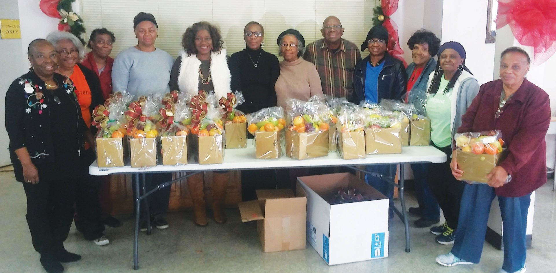 The Tremont Temple Home Mission Ministry prepared over 40 fruit and gift baskets for the sick and shut in. Preparing the baskets is an annual project of the Home Mission during the Christmas Holiday season. The Deacons delivered the gift baskets. Sis. Annette Mitchell chaired the Fruit and Gift Basket project. Sis. Phyllis Garrison is the President. Rev. Quentin J. Morris, Sr. is the Pastor