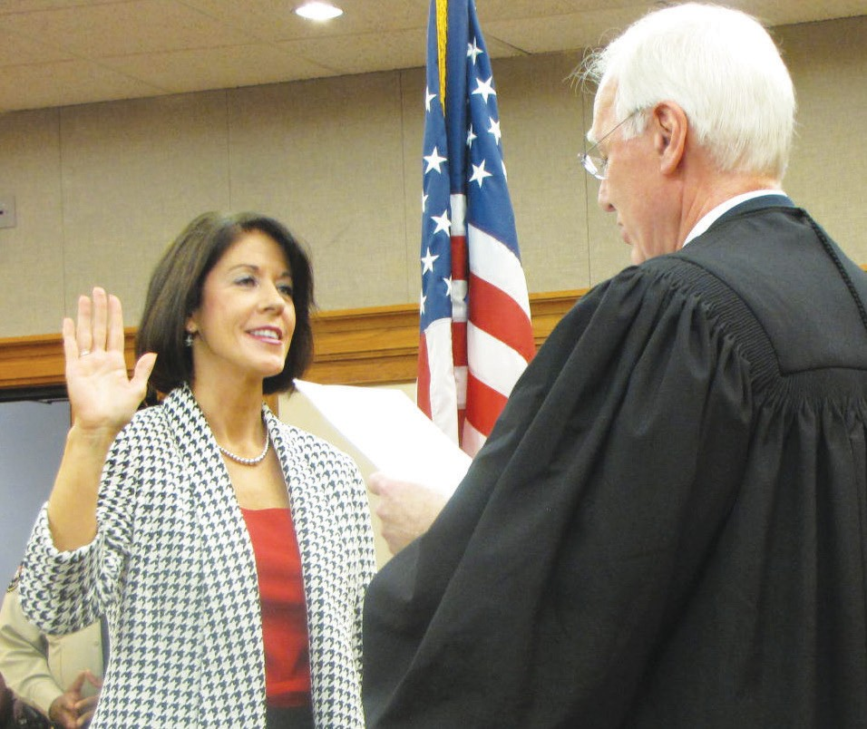 District Attorney Meg Heap is sworn in by Judge Tom Bordeaux